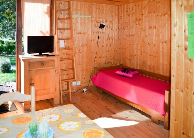 Our chalets 2 adults + 1 child are equipped with a sofa bed + a bed in mezzanine
